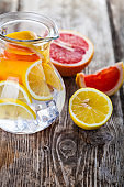 Refreshing ice cold water with lemon and grapefruit