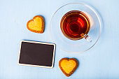 Heart-shaped biscuits and tea