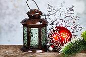 Christmas lantern, fir branch and snowflake