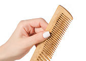 Comb with hair in hand