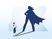 Businesswoman with superhero shadow vector concept. Business symbol of emancipation ambition, success and motivation of leadership