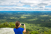 Woman takes a snpashot of the Hudson Valley, NY