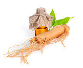 Ginseng root with pharmaceutical bottle and leawes.