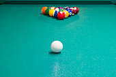 table for billiards with multi-colored balls, close-up