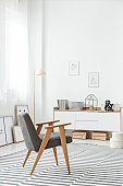 White sideboard in stylish interior