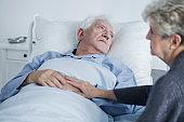 Sad elders at hospital