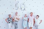 Elderly people during birthday meeting