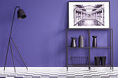 Purple living room with black furniture standing on a checkered floor and a white poster of a factory interior. Real photo