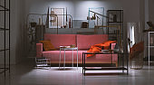 Night view of powder pink sofa with orange pillow and blanket in the middle of art collector's apartment full of metal shelves and abstract paintings, real photo made