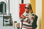 Woman using smartphone walking in a city Travel Lifestyle concept modern technology communication