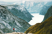 Traveling Man enjoying Naeroyfjord mountains landscape aerial view Lifestyle concept adventure active vacations outdoor hiking sport in Norway