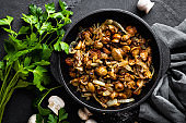 Mushrooms fried with onion, top view