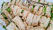 Freshly prepared sandwiches arranged on a large plate
