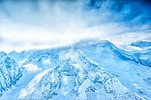 scenery of winter sunny day of high Dombaj mountains in National Park, Russia
