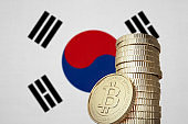 Bitcoin stack with South Korea flag in the background
