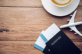 top view  passport and smartphone on wooden table, for travel concept