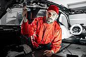 Worker disassembling car interior