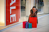 Beautiful girl is shopping in the mall