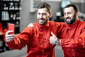 Portrait of a two happy car service workers