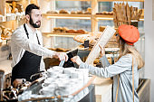 Buying a baguette in the bakery store