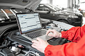 Diagnosing car engine with a laptop