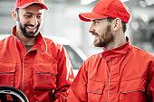 Auto mechanics serving luxury car at the car service