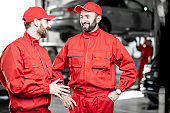 Auto mechanics at the car service