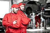 Portrait of an auto mechanics indoors
