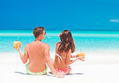 couple with coconuts at tropical beach