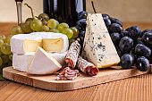 Camembert, blue cheese and dry sausage snack