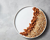 Ingredients for homemade oatmeal granola in a plate