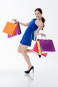beautiful glamour asian female with many shopping bag enjoy shopping and happiness cheerful fun acting pose white background