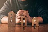 designer hand present wooden shape house model home insurance ideas concept
