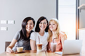 friend together girl friend sit and relax at coffeeshop with happiness and joyful moment