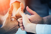 group of business teamwork hand togetrher with thumbs up for successful deal and concept