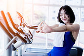 young cute asian girl wear sport wear is relax after cadio workout in fitness health club