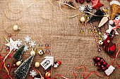 festive celebration background with christmas decorating items on old vintage rattan floor with free copy space