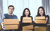 Three start up business partner is holding delivery boxes ready to send out to customer