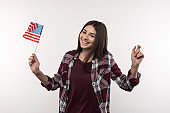 Nice cheerful woman holding the US flag