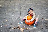 Little girl and Jack O'Lantern