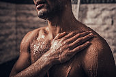 Close up. Young Afro-American Man Taking Shower.