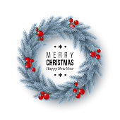 Christmas wreath with realistic fir-tree branches and berries. Decorative design element for holiday posters, flyers, banners. Greeting text, white background, vector illustration.