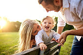 Happy family in a park in summer autumn