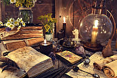 Still life with old-fashioned lamp, magic witch books, tarot cards and old papers.