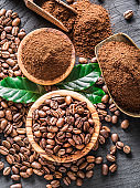 Roasted coffee beans  and ground coffee.
