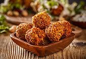 Falafel balls in wooden bowl