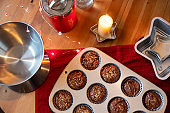 Aerial composition with muffins before baking on festive time.