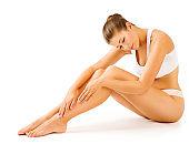 Woman Legs Body Beauty, Sitting Female in White Underwear Touching Leg, Girl Skin Care Hair Removal