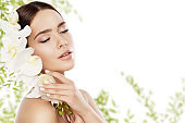 Beauty Skin Care and Face Makeup, Woman Skincare Natural Make Up, Model with Orchid Flower