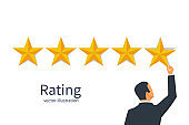 Star rating. Businessman holding a gold star in hand